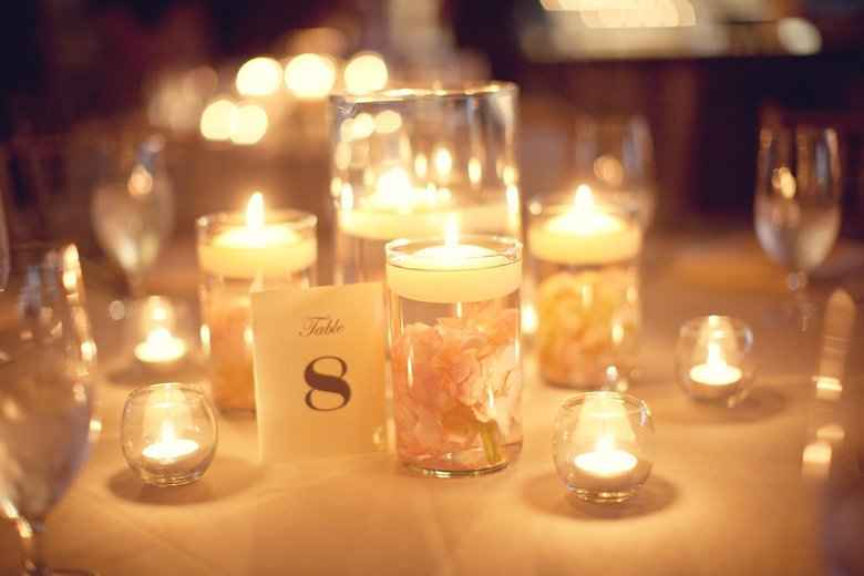Image courtesy of: https://www.onewed.com/photos/show/romantic-wedding-reception-table-hurricane-vases-candles/